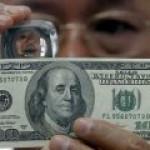 Доллар потерял свой исторический статус