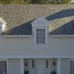 Tesla Motors начнет выпуск панелей солнечных батарей в виде крыш домов