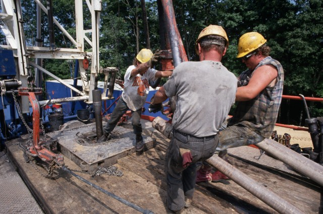Drilling Crew Connecting Pipes